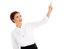 Beautiful woman pointing above her head Royalty Free Stock Photos