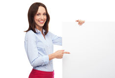 Beautiful woman pointing at blank board Royalty Free Stock Photos