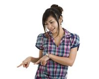 Beautiful woman pointing down Stock Photography