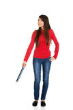 Beautiful woman pointing down with a big pencil. Royalty Free Stock Photography