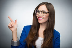 Beautiful woman pointing finger Stock Photography