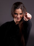 Beautiful woman pointing out her finger Royalty Free Stock Image