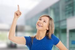 Beautiful woman pointing somewhere Royalty Free Stock Photo