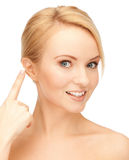 Beautiful woman pointing to ear. Bright closeup portrait picture of beautiful woman... pointing to ear stock photos