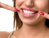 Beautiful woman pointing to her teeth Stock Image