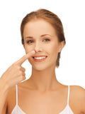 Beautiful woman pointing to nose Royalty Free Stock Photography