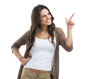 Beautiful woman pointing to something Stock Image