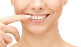 Beautiful woman pointing to teeth. Dental health concept - beautiful woman pointing to her teeth Royalty Free Stock Photo