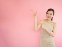 Beautiful woman pointing two fingers left Royalty Free Stock Images