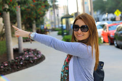 Beautiful woman pointing up to the corner Royalty Free Stock Images