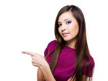 Beautiful woman points a hand Stock Photo