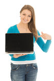 Beautiful woman points at a screen Stock Photography