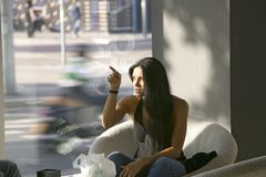 Beautiful woman points to her right in hotel in Barcelona Spain - MODEL RELEASE Royalty Free Stock Photography