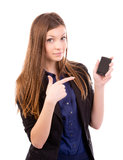 Beautiful woman points to phone royalty free stock photography