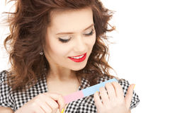 Beautiful woman polishing her nails Royalty Free Stock Photo