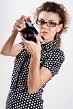Beautiful woman in a polka dot dress with camera Stock Image