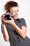 Beautiful woman in a polka dot dress with camera Stock Photo