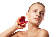Beautiful woman with pomegranates in her hands Royalty Free Stock Image