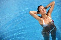 Beautiful woman in pool Royalty Free Stock Image