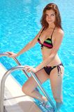 Beautiful woman on the pool royalty free stock photo