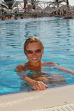 Beautiful woman in pool. Beautiful woman in a swimming pool Stock Image