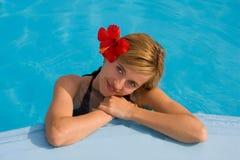 Beautiful woman in pool Stock Photography