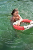 Beautiful woman in the pool. Beautiful woman enjoying the sun in the pool Royalty Free Stock Images