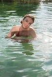 Beautiful woman in the pool. Beautiful woman enjoying the sun in the pool Stock Images