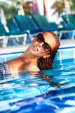 Beautiful woman in the pool Stock Photos