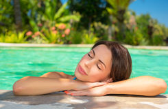 Beautiful woman in the pool Royalty Free Stock Photography