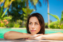 Beautiful woman in the pool. Portrait of a beautiful calm woman in a swimming pool, relaxing in a cold refreshing water on hot summer day, spending holidays on Stock Photos