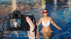 Beautiful woman in the pool. Reflex camera Royalty Free Stock Images