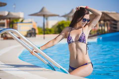 Beautiful, woman in pool. Sexy woman is relaxing in the pool Royalty Free Stock Photo