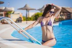 Beautiful, woman in pool Royalty Free Stock Photo