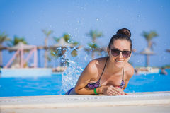 Beautiful woman in pool Royalty Free Stock Photo