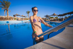 Beautiful woman in pool. Sexy woman is relaxing in the pool Stock Images