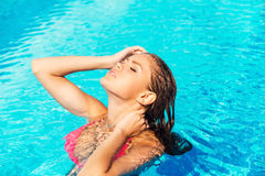 Beautiful woman at the pool. Stock Image