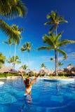 Beautiful woman in pool. Beautiful woman in swimming pool. Relaxation Royalty Free Stock Image