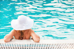 Beautiful woman in the pool Stock Photos