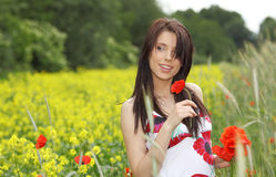 Beautiful woman in poppies field Royalty Free Stock Images