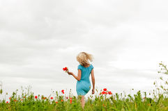 Beautiful woman in poppy field Stock Photography