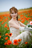Beautiful woman in poppy field Stock Image