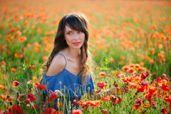 Beautiful woman in poppy field Royalty Free Stock Images
