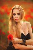 Beautiful woman in a poppy field Royalty Free Stock Image