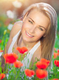 Beautiful woman on poppy field Stock Photography