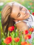 Beautiful woman on poppy flower field stock image