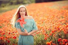 Beautiful woman on poppy flower field Stock Photo