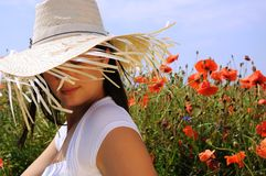 Beautiful woman in poppy flowers Royalty Free Stock Photos