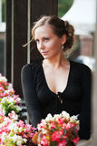 Happy beautiful fashion woman with flowers outdoor Stock Photos