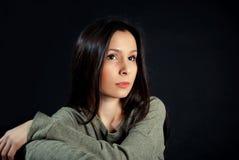 Beautiful woman portrait. Beautiful young woman posing on black background Stock Photo
